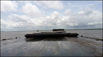 Barge rolls  into water with airbags from carrier deck