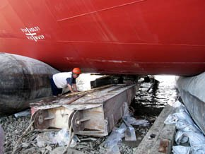 Airbag jack up stranded ship